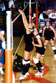 Sara Poje blocks a ball in a Neosho County volleyball game this fall. Poje, a Tonganoxie alum, earned all-conference and all-region honors with the Panthers this year, and has received interest from Illinois and Benedictine.