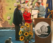 Kansas Gov. Kathleen Sebelius and her husband, Gary, accept a framed drawing of the Kansas quarter design from David Lebryk, acting director of the United States Mint. About 5,000 people attended the quarter launch, held Friday morning at the Kansas State Fair in Hutchinson. The coins went into circulation Friday. Between 550 million and 650 million of the quarters will be minted, half of which will be made at the Philadelphia mint and the other half at the Denver mint.