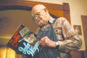 John Quasa takes a look through his book about John Wayne.