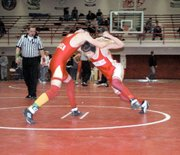 Shawn Everhart tries to make a move on Atchison's Chris Deshong on Saturday at the Randy Starcher Memorial Invitational in Tonganoxie. Deshong pinned Everhart in the 125-pound consolation match, while the Chieftains finished second to Atchison overall.