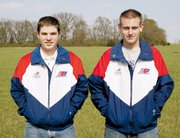 Anthony Lutz, left, and Cody Owsley, wear their USA shooting sports jackets.