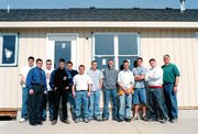 Among the building and trades students working on this house are, from left, Matt Depetrie, Jason McBroom, David Saultz, Lance Thompson, Ronnie Edmonds, Chris Laurent, Brett VanDyke, David Lindquist, Jeffrey Dennis, Andrew Miller and Lucas Frantz. With the students is their instructor, Steve Hughes.