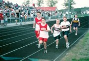 Tyler Gurss, left, and Tyler Sparks, second from left, run the 800 meters at last Wednesday's Tonganoxie Junior High Invitational. The meet marked the Warriors' second and last home meets of the season. Look inside for additional junior high coverage.