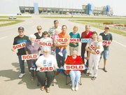 These area residents gathered outside the Kansas Speedway recently. Each of them lost their home to the race track and nearby commercial development.