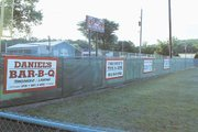 Sponsors' signs decorate the outfield fences at the Tonganoxie Recreation commission ball fields. New green fencing and red shale for infields were also added this summer to the venues.