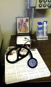 A corner of a desk in one of the examining rooms in Dr. Philip Stevens' office. Stevens' abilities to diagnose are well-known among his patients.