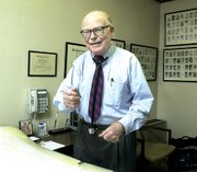 "Dr. Philip Stevens in his tidy Tonganoxie office talks about changes in the medical profession during his nearly 48 years of practice. ""When I started my practice, half of our patients were farmers. ... Now it's down to one or two percent,"" he said."