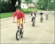 Andrew Eveland, Tonganoxie, leads his friends Curtis Marks, Jason Marks and Chuck Wilson down the street Saturday afternoon. The boys say that they want the city to build a park with ramps and a half-pipe, like Lawrence did, so they can do more than just ride up and down the streets.