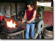 Jim Bevan manned the blacksmith shop Saturday afternoon at the McLouth Threshing Bee