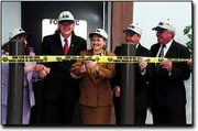 Kansas Attorney General Carla Stovall performed the honors Friday at a dedication of the Kansas Bureau of Investigation lab. From left, are Barb Schilling, U.S. Rep. Dennis Moore, D-Kan., Stovall, State Rep. Tom Burroughs and Tom Burke, president of Kansas City Kansas Community College.