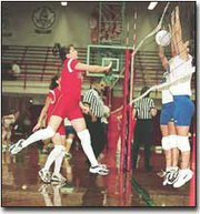 Laura Samuels, sophomore, just misses getting the ball over the net in last Tuesdays junior varsity game.