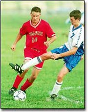 Jacob Hoffhines, senior defenseman, works the ball in Tonganoxie's 4-0 victory over Perry-Lecompton on Oct. 3.