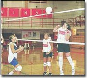 Sarah Holliday punches the ball over the net in Thursdays freshman tournament at Tonganoxie. All Tonganoxie High volleyball teams battled adversity last week. The freshmen team beat Perry-Lecompton 15-12, 13-15, 15-12, but lost to Lansing 4-15, 1-15.