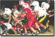 James Hartshorn, No. 57, joins the wall of Chieftains stopping the Bobcats.