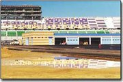 Construction continues on infield pavement and garages of the Kansas Speedway, which will open next April near Interstates 70 and 435 in Kansas City, Kan.