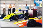 Adam Saal, public relations director for American Racing Series, spoke at a Kansas Speedway press conference last Wednesday. To his right is a Dayton Indy Lights racecar. Also pictured, from left, are Jeff Boerger, Kansas Speedway vice president, Grant Lynch, Kansas Speedway president, Roger Bailey, president and CEO of Dayton Indy Lights, and Stann Tate, director of public relations for Kansas Speedway.
