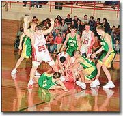 A gang of Chieftains scramble for the ball during a junior varsity game on Dec. 19 game against Basehor-Linwood. Tonganoxie lost that game 37-75. The varsity team also lost to the Bobcats, 47-57.