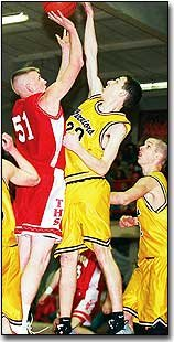 Tonganoxie's Scott Breuer, above, shoots over an Olathe Christian player on Saturday during the Tonganoxie Invitational Basketball Tournament.