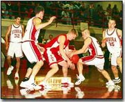 Breuer and a Eudora player battle for the basketball in Friday's game. Eudora won the eight-team tournament.