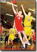 The Chieftains' Matt Needham angles for a layup during Tonganoxie's game against Olathe Christian on Saturday. Tonganoxie won the game, to take third in the Chieftains' invitational basketball tournament.