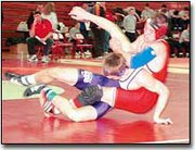 Pat Weyer, who wrestles for Tonganoxie High School at 152 pounds, wrestles against Louisburg's Trent Campbell during the first round of Saturday's Osawatomie Invitational Tournament. Weyer finished fourth in his weight class. The Chieftains finished fourth overall at the 10-team tournament.