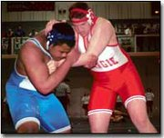 Senior Tony Miller battles Sumner Academy's Rhett Caviel in the 275-pound consolation final match in Holton.