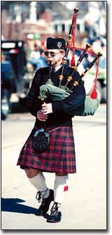 John Whipple, a member of Pipers of the Plains, Topeka, warmed up on his bagpipe before the St. Pat's parade began.
