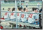 Members of Tonganoxie High School's softball team wait for their turns to bat during Thursday's double header with Basehor-Linwood. The Bobcats beat the Chieftains in both games.