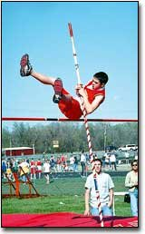 Clay Lamb doesn't quite make it over the bar during a pole vault competition last Wednesday at the Tonganoxie Junior High School track meet. Both the seventh- and the eighth-grade team took first at the meet.