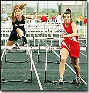 Aimee Eisman leads the pack in the high hurdles. She took first in the event. The girls team took third at the meet.