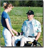 Home on a six-hour leave Saturday from the University of Kansas Medical Center, Tony Maurer visits with his girlfriend, Kristen Riley, at the home of his parents, Leroy and Sue Maurer. Maurer suffered back injuries in an April 1 four-wheeler accident. His legs were not hurt, but were bandaged to help regulate his blood pressure.
