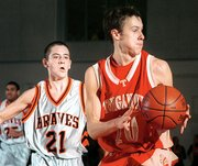 Bonner Springs senior Jeremy Krug looks on as Tonganoxie's Shane Howard drives toward the basket Friday. Howard had 18 points against Lansing on Monday in substate, but the output wasn't enough as the Chieftains fell, 70-59. THS ended the season with a 4-17 record.