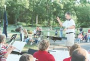 Tonganoxie band director Charles VanMiddlesworth directs the Tonganoxie community band at the July 2 concert in the park.