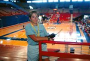 Vicki Hill, director of the Sunflower State Games, supervises basketball games in Allen Fieldhouse on the University of Kansas campus in Lawrence. Hill, a rural Tonganoxie resident, is in her second year as director of the games.