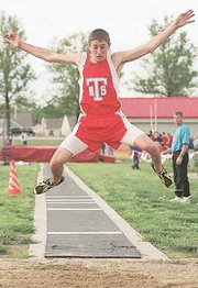 Jacob Walker stretches for more inches in the long jump Friday in Tonganoxie.