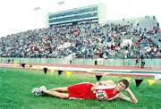 Jacob Walker won a gold medal in the triple jump Friday in the sandpits just beyond where he is laying at Cessna Stadium in Wichita.Walker won the event in Class 4A with a mark of 43 feet, 6 inches. That also broke his own school record he set about two weeks earlier.