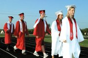 The class of 2003 filed into the stadium, ready to graduate from Tonganoxie High School.