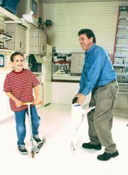 West and his son, Taylor, share a moment of laughter in their garage.