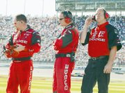 Bill Elliott's crew watches in visible disappointment during the final laps of the Winston Cup race Sunday afternoon at Kansas Speedway. Elliott, who had held the lead earlier in the 400-mile race, crossed the finish line just eight-tenths of a second behind winner Ryan Newman.